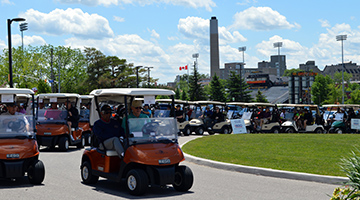 Golfers heading out in their carts at 2016 FOH