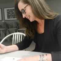 Lynda Murray, FGGH Board Chair signing cheque