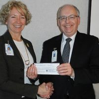 Suzanne presents cheque to Hospital Chair