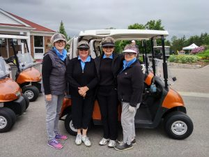 Team of golfers and their cart