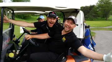 Golfers making funny faces on their cart