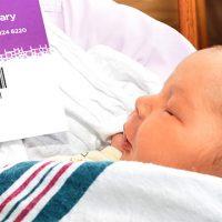 Baby Hugh receiving his library card