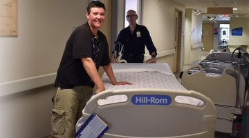 Team of GGH staff helping prepare new beds.