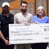 Lago family presenting proceeds from golf tournament
