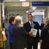 Rober Cameron of FGGH taking group on tour of diagnostic imaging department