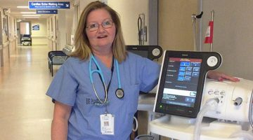 Respiratory therapist beside ventillator