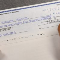 Pual Osborne Signing Cheque to GGH