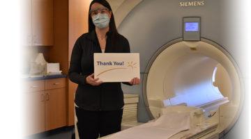 MRI Technologist holding TY Sign