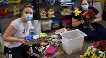 GGF Caregivers assembling activity kits for seniors