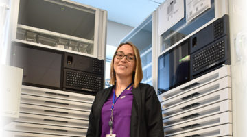 Chelsea Harris RPhT, Pharmacy Department, GGH stands beside medication cabinets that she is preparing for use.
